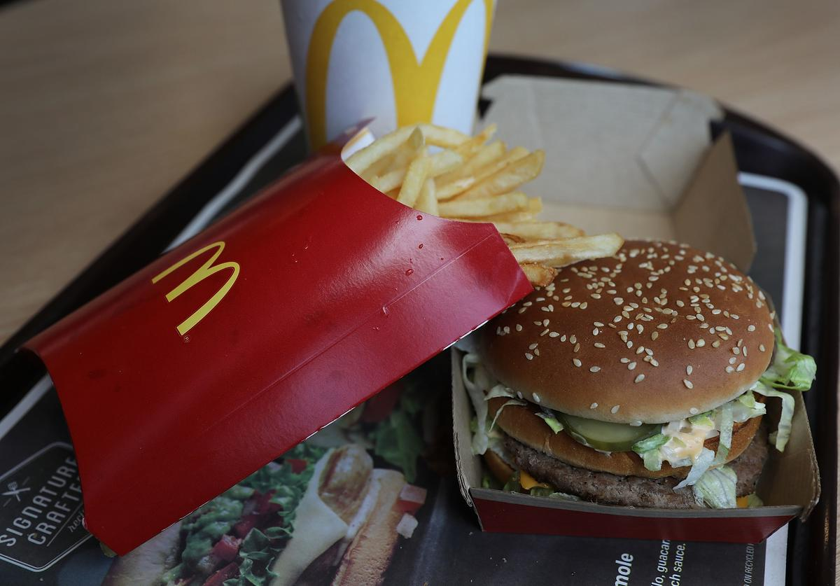 In this photo illustration, a McDonald's Big Mac and french fries are seen on a tray on April 30, 2018 in Miami, Florida. The fast-food restaurant reported today that earnings and sales beat expectations.