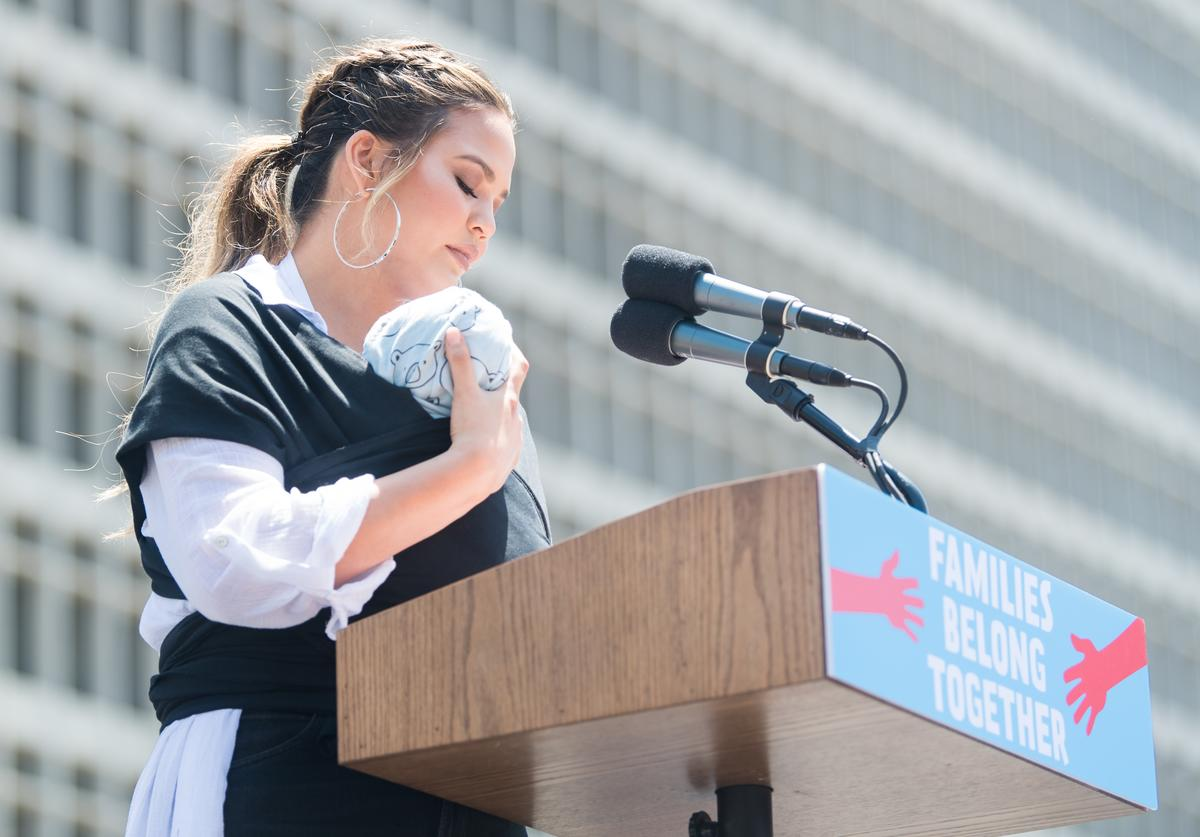 Chrissy Teigen speaks onstage at 'Families Belong Together - Freedom for Immigrants March Los Angeles' at Los Angeles City Hall on June 30, 2018 in Los Angeles, California