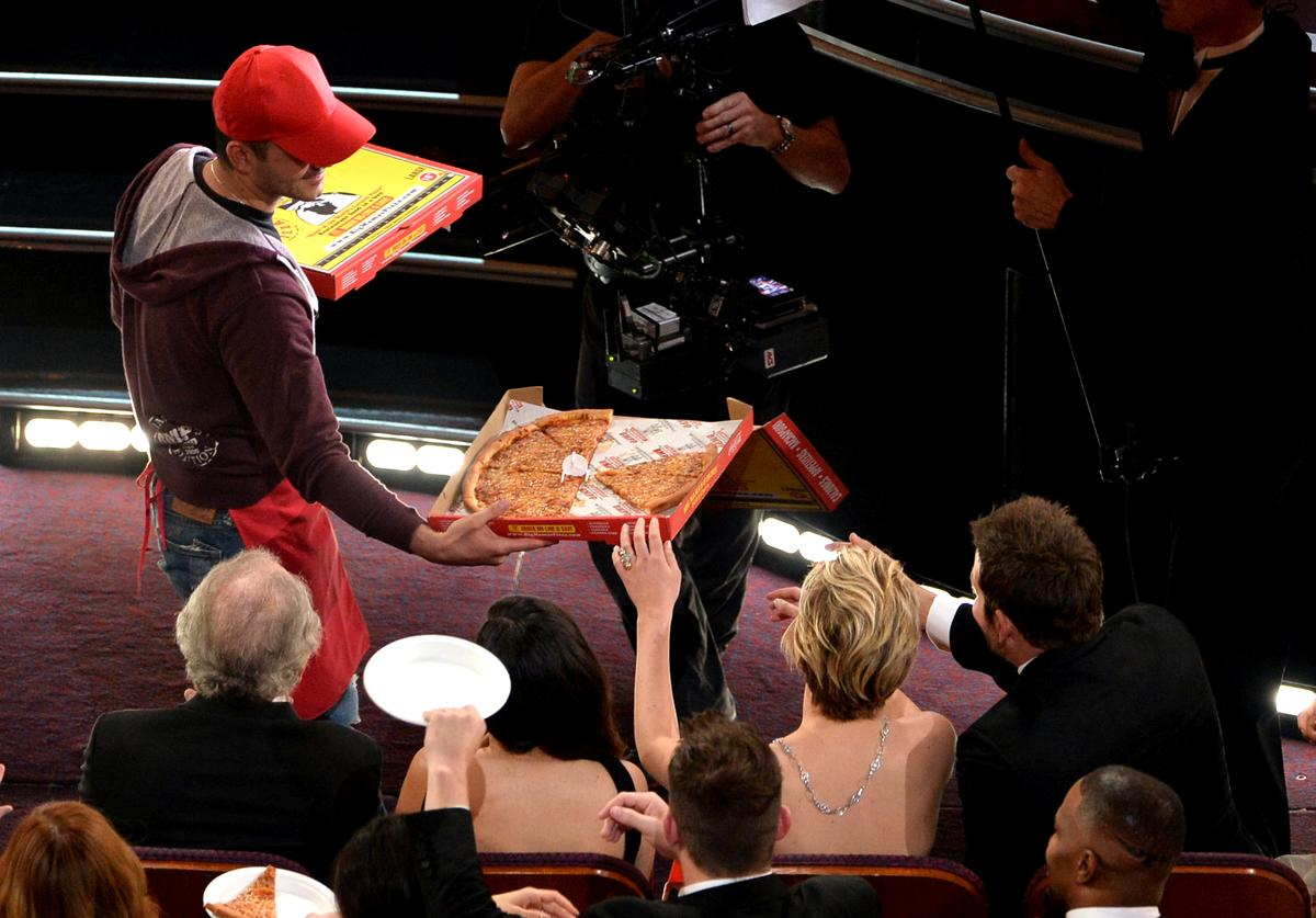 Pizza delivery man in the audience during the Oscars at the Dolby Theatre on March 2, 2014 in Hollywood, California.