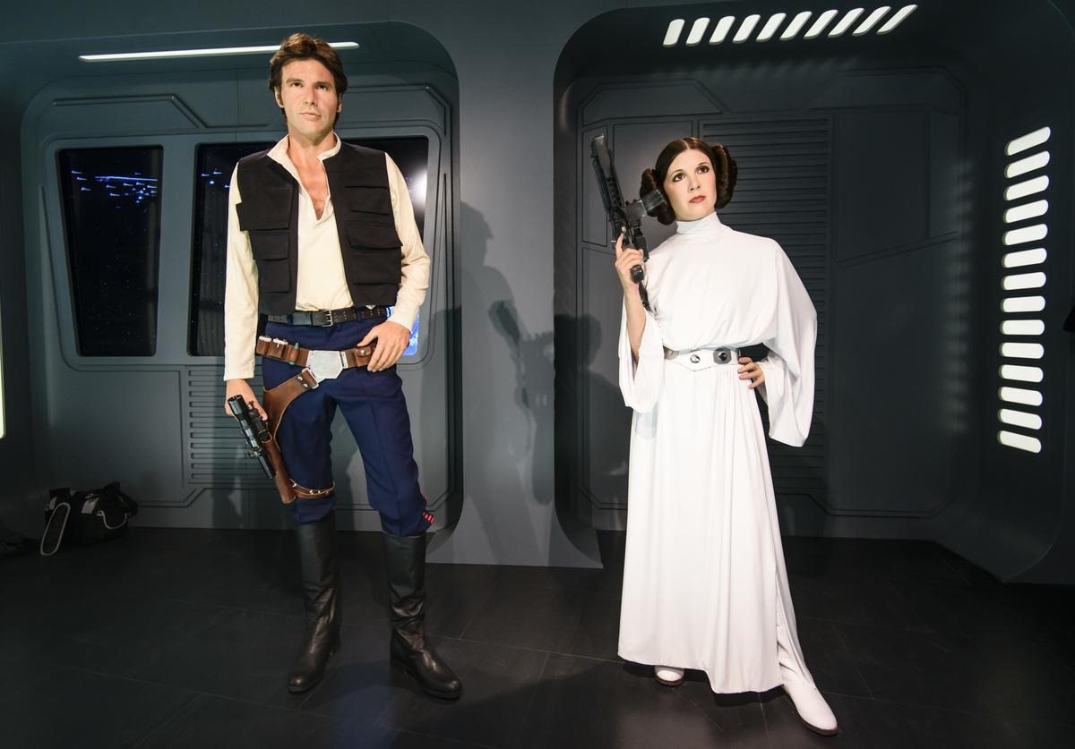 Wax figures of the actors Harrisson Ford as the Star Wars character Han Solo (L) and Carrie Fisher in her role of Leia Organa are displayed on the occasion of Madame Tussauds Berlin Presents New Star Wars Wax Figures at Madame Tussauds on May 8, 2015 in Berlin, Germany.
