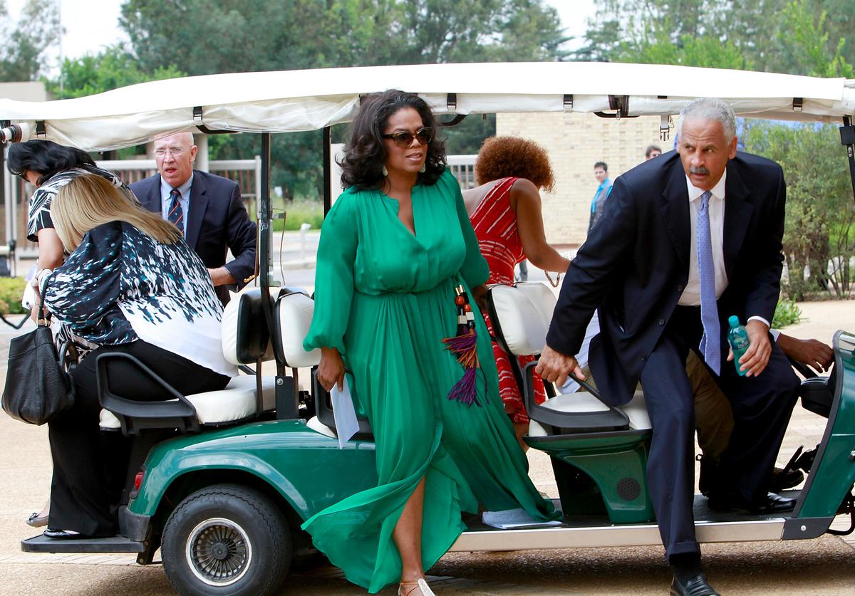 Oprah Winfrey and Stedman Graham (R) arrive at the inaugural graduation of the class of 2011 at Oprah Winfrey Leadership Academy for Girls on January 14, 2012 in Henley on Klip, South Africa.