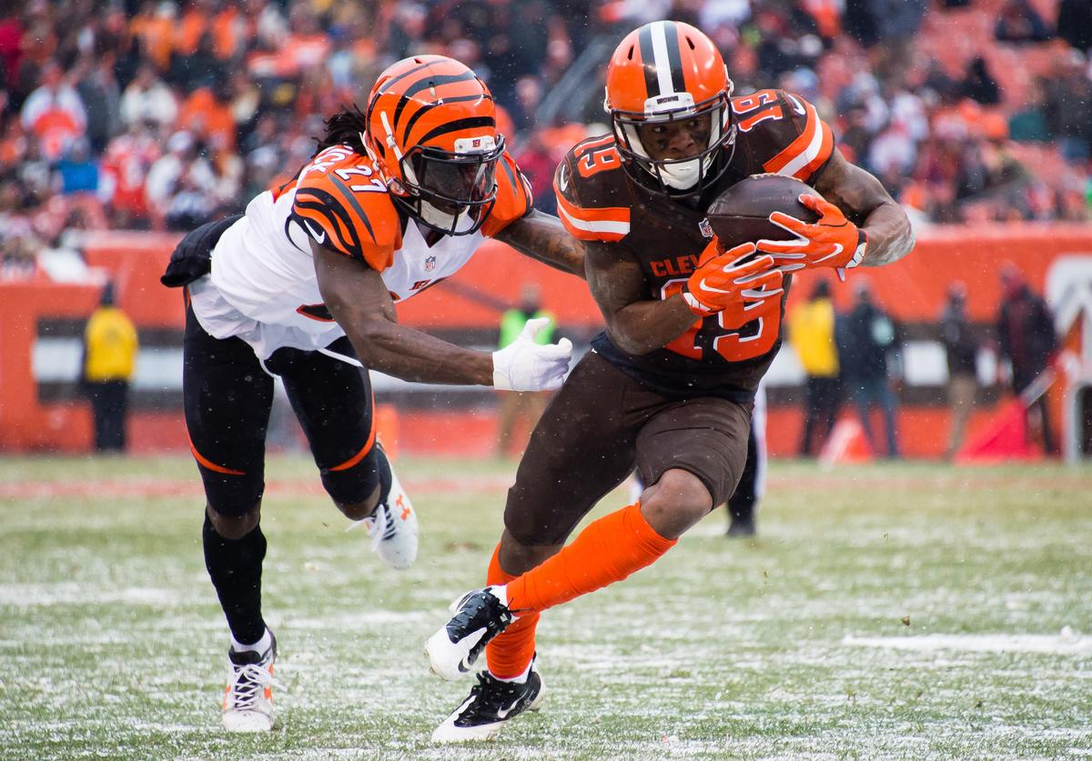 Cornerback Dre Kirkpatrick #27 of the Cincinnati Bengals tackles wide receiver Corey Coleman #19 of the Cleveland Browns during the second half at FirstEnergy Stadium on December 11, 2016 in Cleveland, Ohio. The Bengals defeated the Browns 23-10.