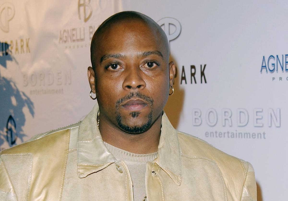 Rapper Nate Dogg attends the Style by the Shore fashion show hosted by clothing designer David Park at Malibu Beach on October 12, 2002 in Malibu, California.