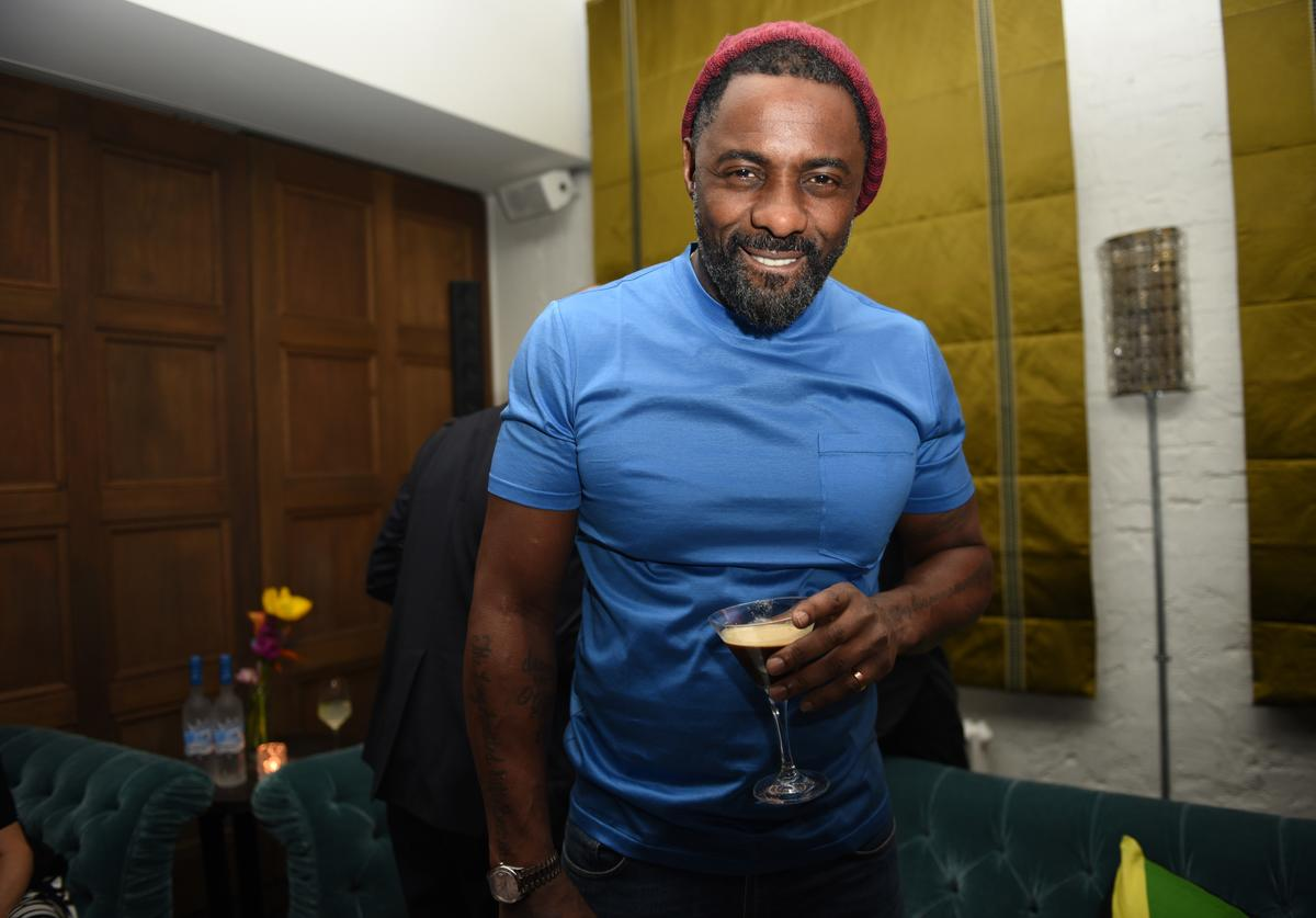 Idris Elba enjoying a Grey Goose Espresso Martini cocktail during the Grey Goose after-party for Idris Elba's film 'Yardie', hosted at Soho House Berlin on February 22, 2018 in Berlin, Germany.