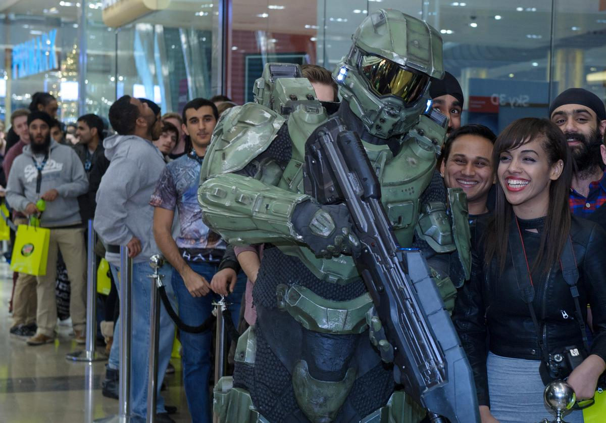 Master Chief poses with fans in line awaiting the launch of Halo 4 on Xbox 360 at Westfield Stratford shopping center on November 06, 2012 in London, England.