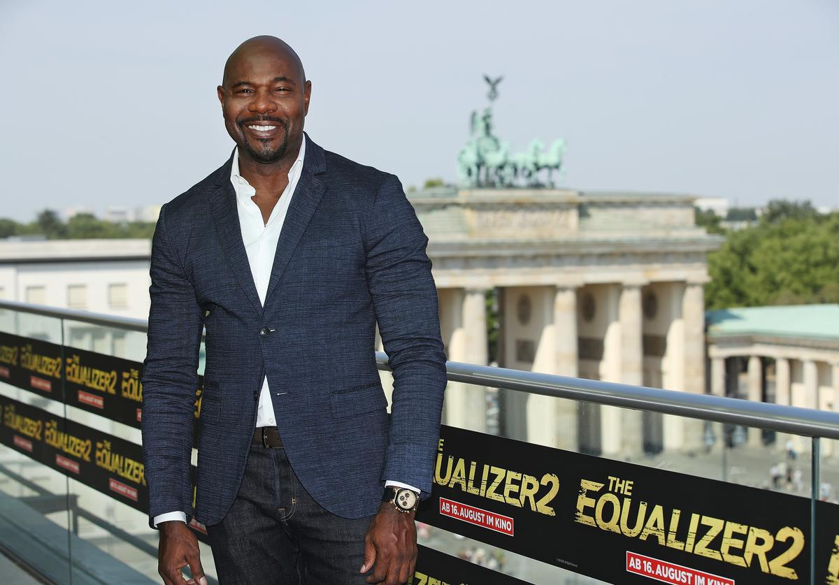Director Antoine Fuqua poses for a photo during the photo call for 'The Equalizer 2' at Akademie der Kuenste as the Brandenburg Gate stand behind on August 8, 2018 in Berlin, Germany.