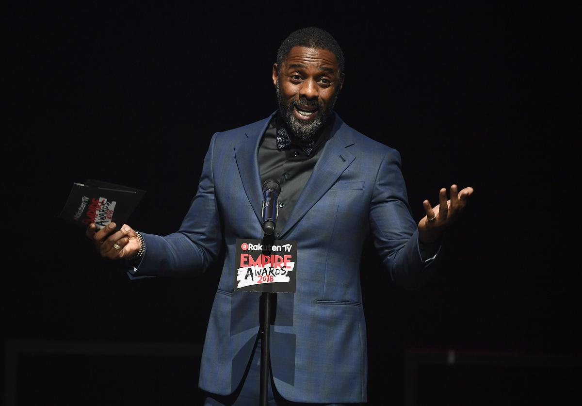 Actor Idris Elba presents the EMPIRE Inspiration award on stage during the Rakuten TV EMPIRE Awards 2018 at The Roundhouse on March 18, 2018 in London, England.