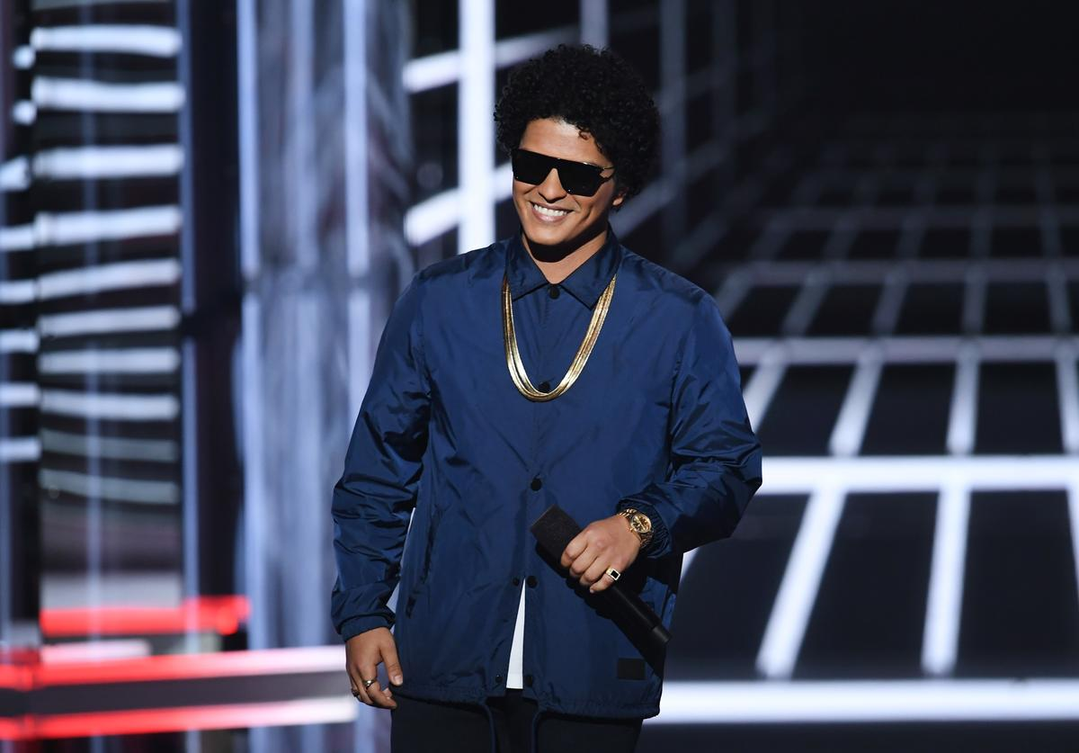 Recording artist Bruno Mars speaks onstage during the 2018 Billboard Music Awards at MGM Grand Garden Arena on May 20, 2018 in Las Vegas, Nevada.