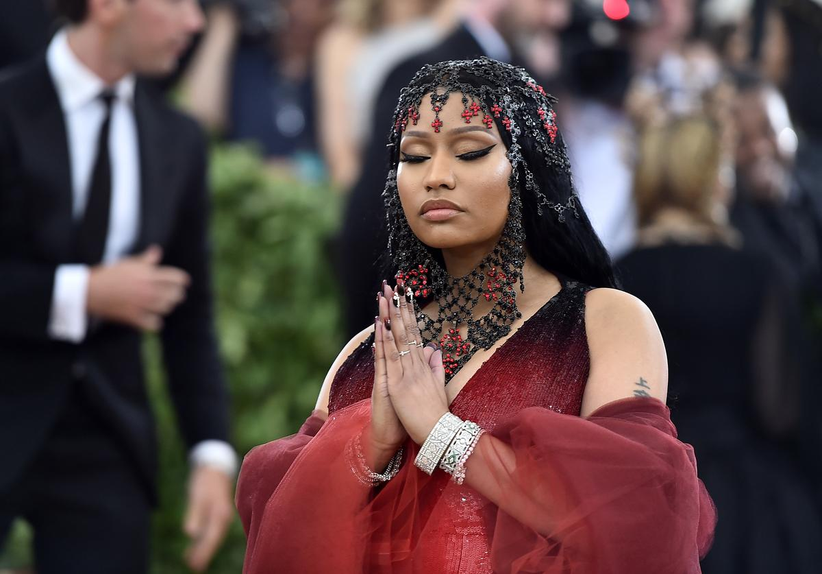 Nicki Minaj with prayer hands