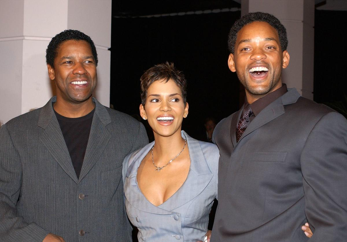 Actors Denzel Washington (L), Halle Berry (C) and Will Smith attend the nominees luncheon for the 74th Annnual Academy Awards March 11, 2002 in Beverly Hills, CA.