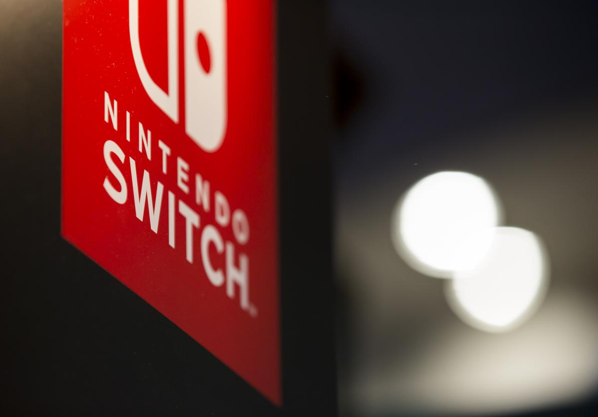 The logo of Nintendo Co.'s Switch video game console is displayed in the Capcom Co. booth during the Tokyo Game Show 2017 at Makuhari Messe on September 21, 2017 in Chiba, Japan. The annual game show, which features games from 345 exhibitors for various platforms from game consoles to mobile phones, takes place September 21-24 and will feature eSports.