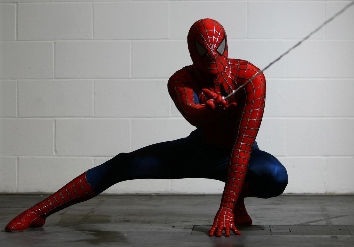 An actor dressed as Spiderman poses for a photo at the London Super Comic Convention at the ExCeL Centre on February 23, 2013 in London, England