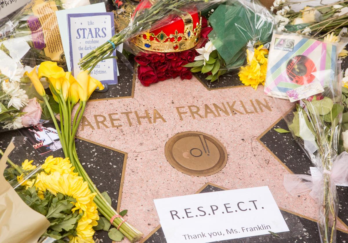 Flowers and mementos are left at a growing memorial at Aretha Franklin's star on the Hollywood Walk of Fame on August 16, 2018 in Los Angeles, California.