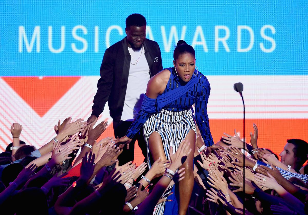 Kevin Hart and Tiffany Haddish speak onstage during the 2018 MTV Video Music Awards at Radio City Music Hall on August 20, 2018 in New York City.