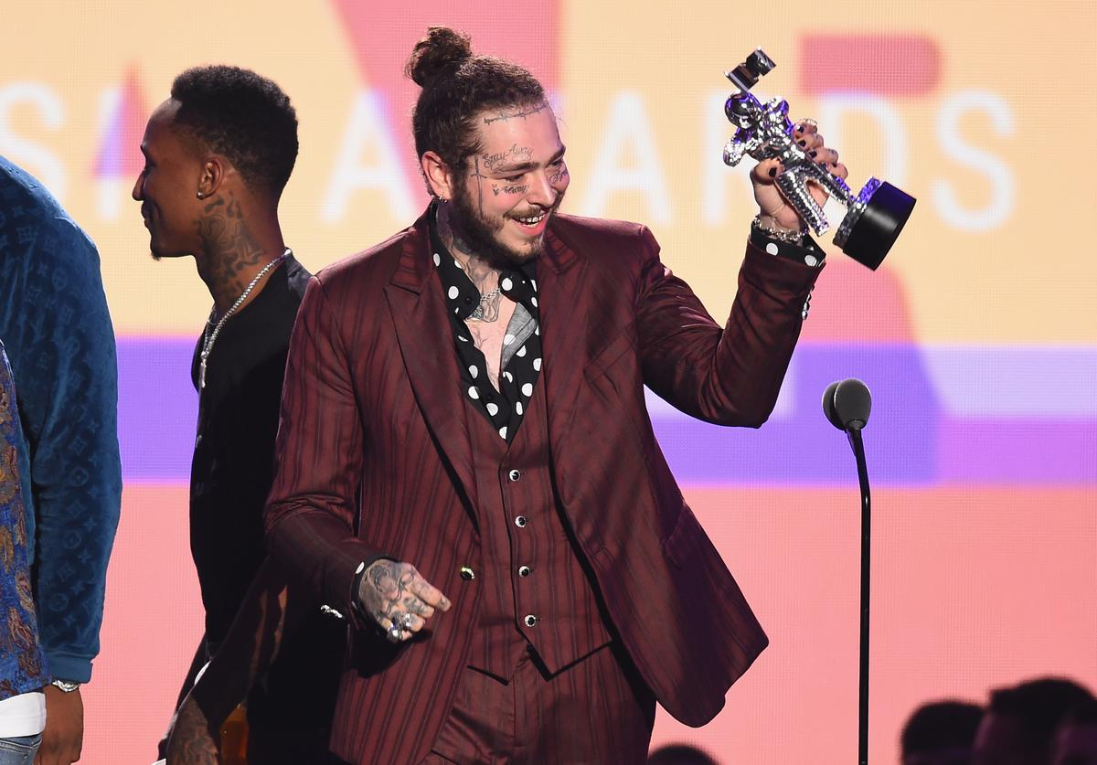 Post Malone accepts the award for Song of the Year during the 2018 MTV Video Music Awards at Radio City Music Hall on August 20, 2018 in New York City.