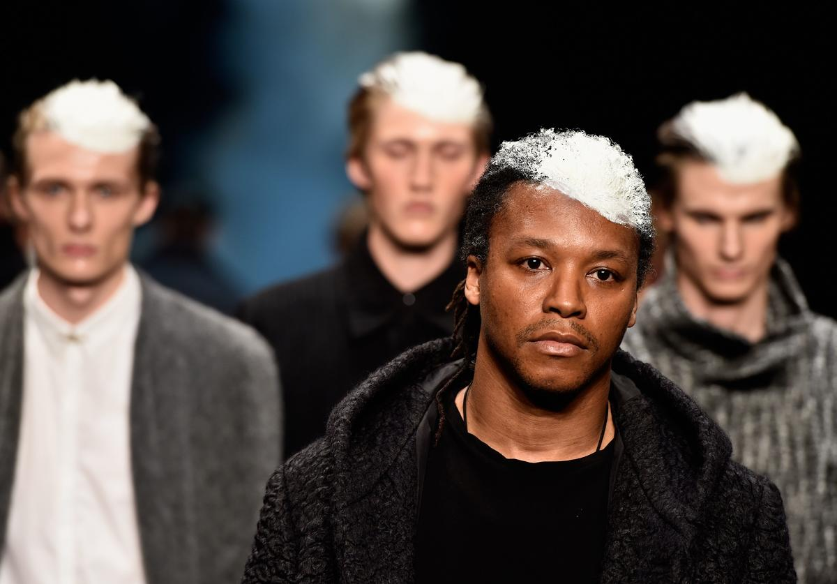 Musician Lupe Fiasco and models walk the runway at the Song For The Mute show during Mercedes-Benz Fashion Week Australia 2014 at Carriageworks on April 10, 2014 in Sydney, Australia.