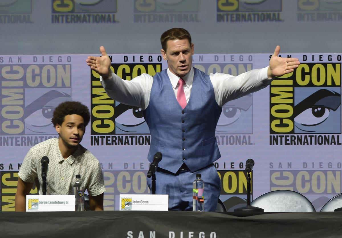 Jorge Lendeborg Jr. (L) and John Cena speak onstage at the 'Bumblebee' panel during Comic-Con International 2018 at San Diego Convention Center on July 20, 2018 in San Diego, California.