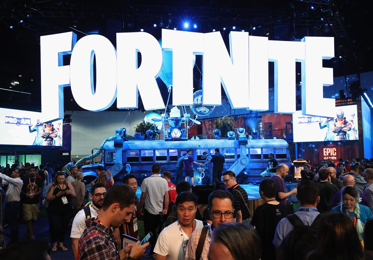 Game enthusiasts and industry personnel visit the 'Fortnite' exhibit during the Electronic Entertainment Expo E3 at the Los Angeles Convention Center on June 12, 2018 in Los Angeles, California.