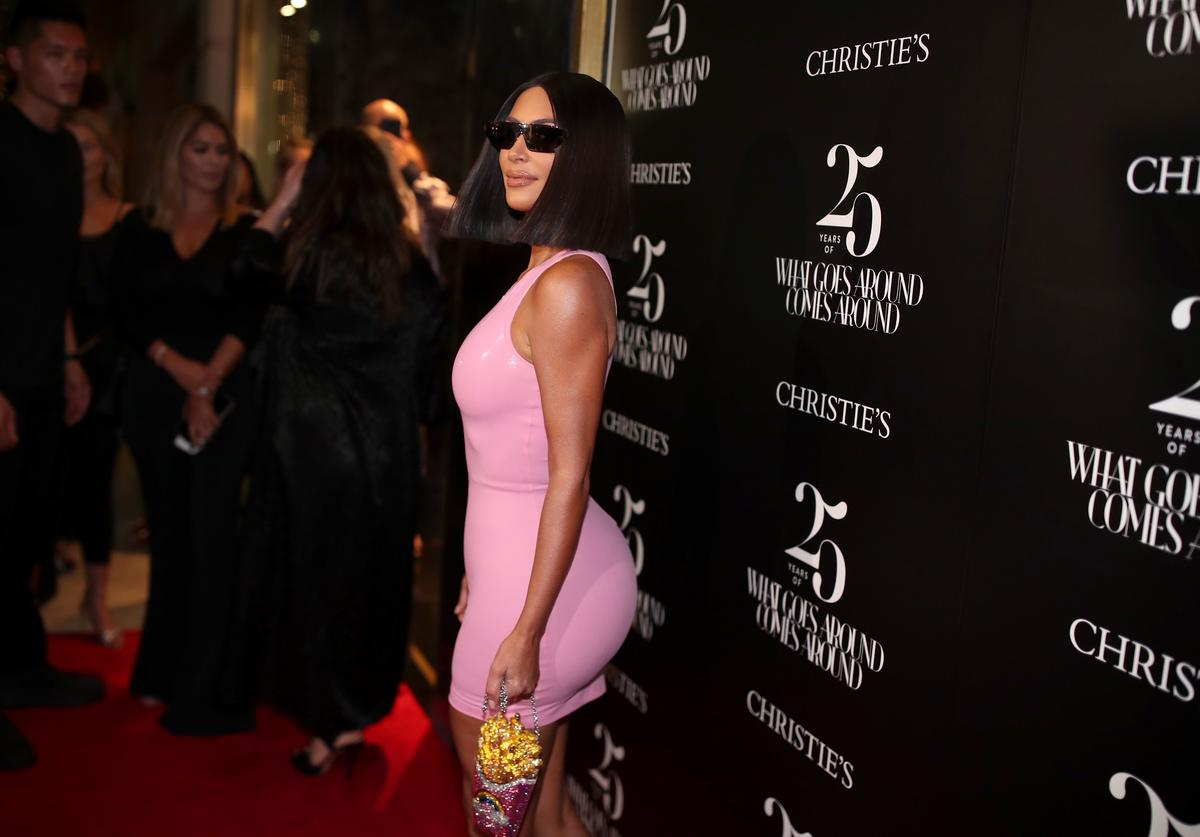 Kim Kardashian in skin tight pink dress