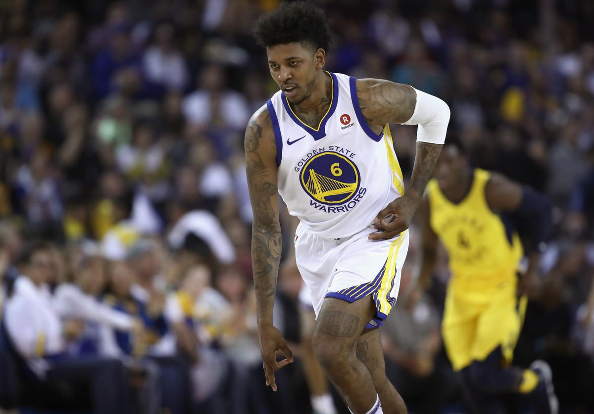 Nick Young #6 of the Golden State Warriors reacts after making a basket against the Indiana Pacers at ORACLE Arena on March 27, 2018 in Oakland, California.