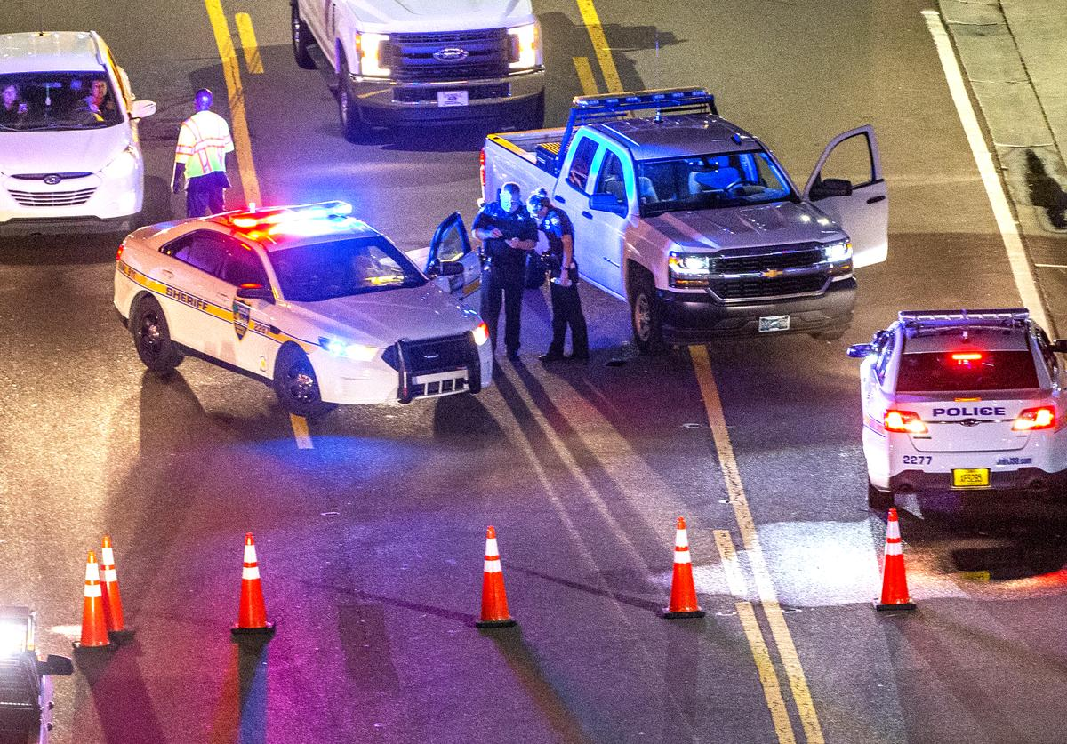 A heavy police presence remains into the night at the shooting outside Jacksonville Landing on August 26, 2018 in Jacksonville, Florida. A shooting rampage during a Madden 19 video game tournament at the site claimed four lives, with several others wounded, according to published reports.