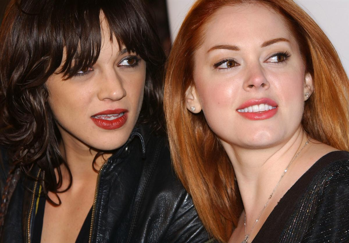 Actresses Asia Argento and Rose McGowan attend the premiere of 'Spun' at Pacific's Cinerama Dome Theater on March 17, 2003 in Hollywood, California.