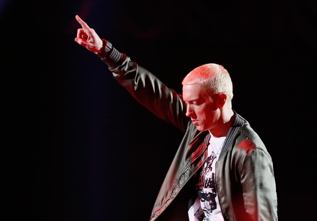 Eminem performs onstage at the 2014 MTV Movie Awards at Nokia Theatre L.A. Live on April 13, 2014 in Los Angeles, California