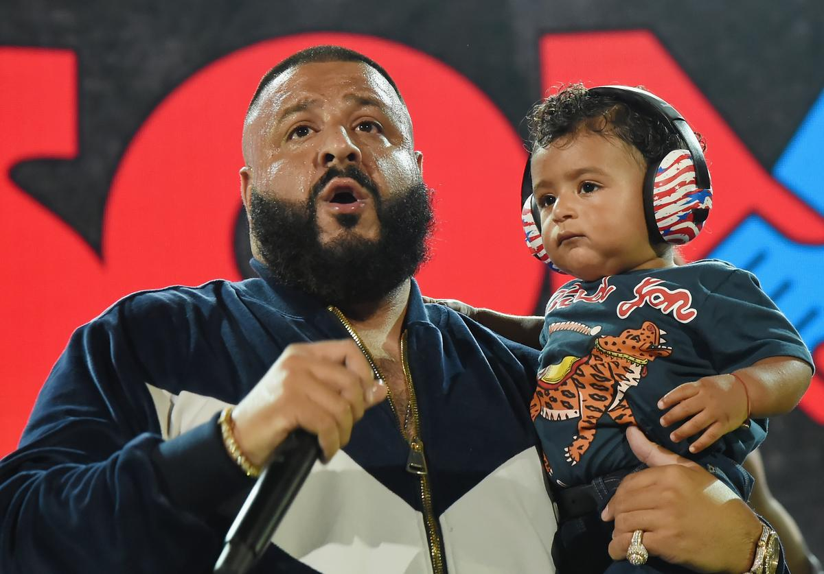 DJ Khaled speaks onstage with son Asahd Tuck Khaled at One Voice: Somos Live! A Concert For Disaster Relief at Marlins Park on October 14, 2017 in Miami, Florida