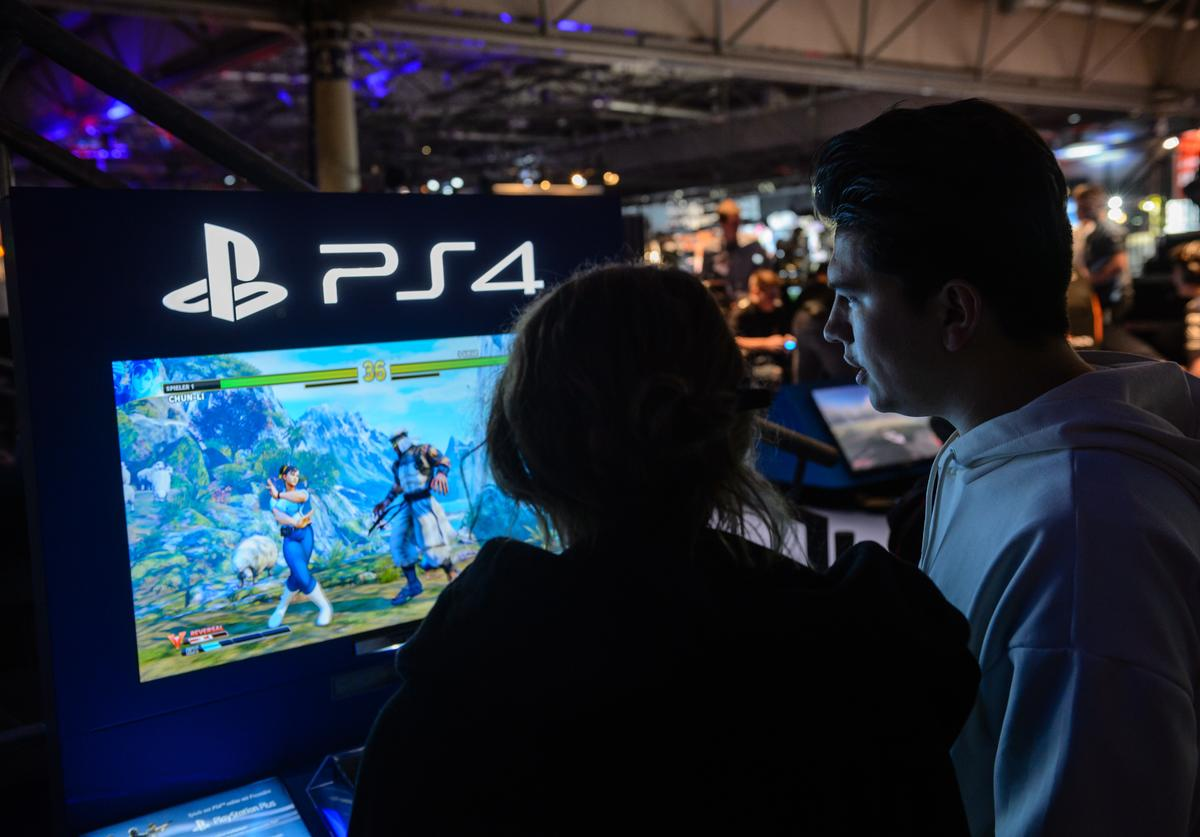 Participants play with the game console PS4 a video games at the 2018 DreamHack video gaming festival on January 27, 2018 in Leipzig, Germany. The three-day event brings together gaming enthusiasts mainly from German-speaking countries for events including eSports tournaments, cosplay contests and a LAN party with 1,500 participants.