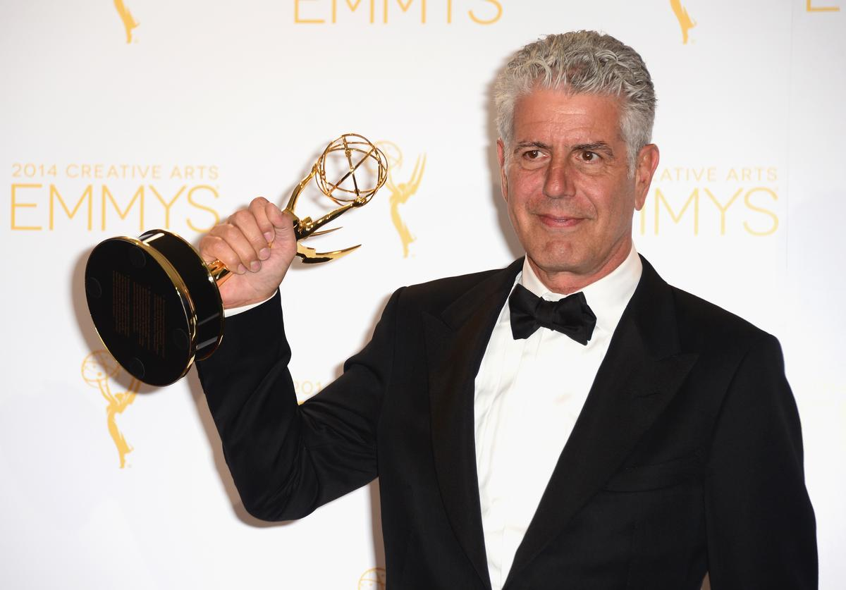 nthony Bourdain poses in the press room during the 2014 Creative Arts Emmy Awards