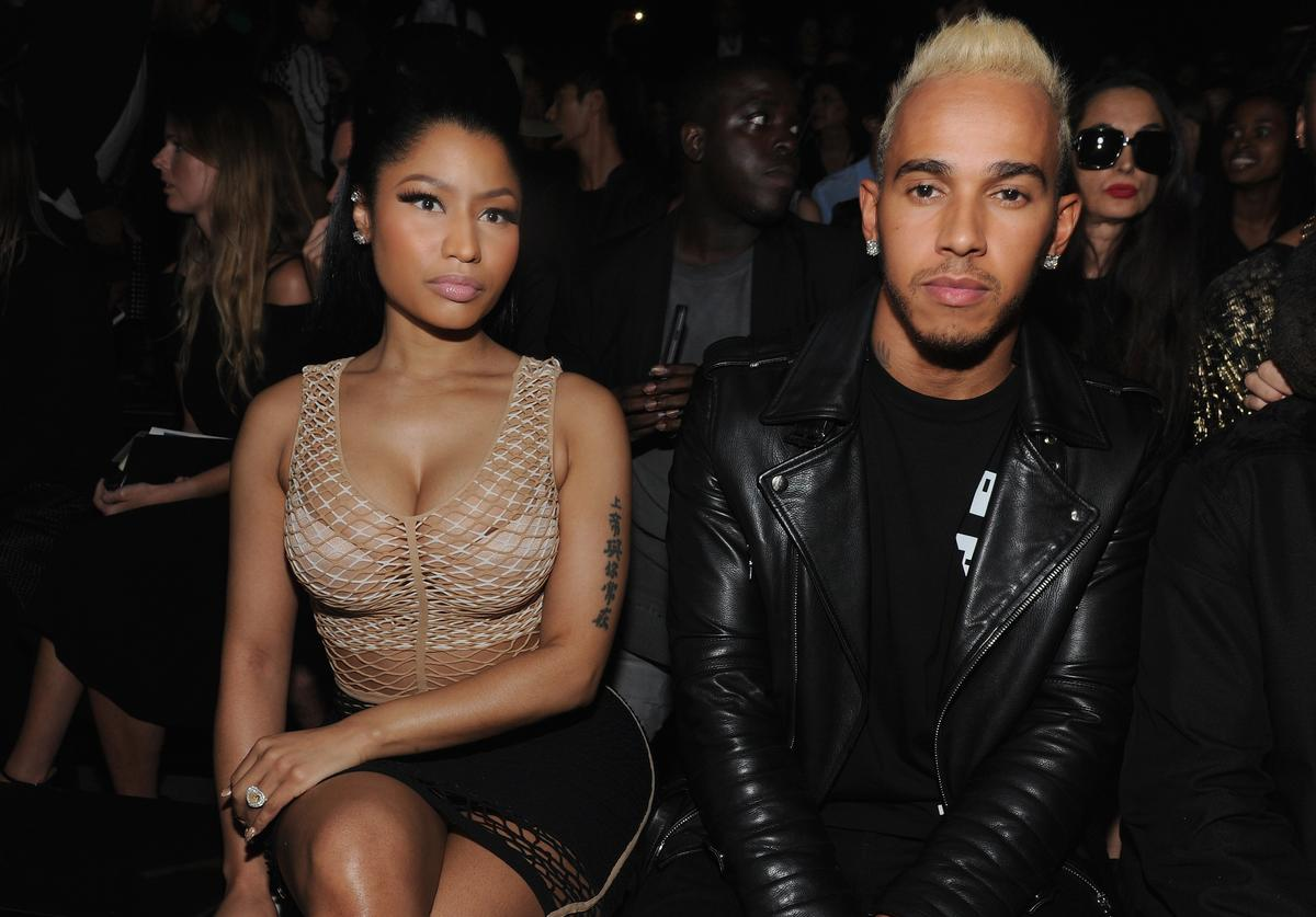 Nicki Minaj (L) and Lewis Hamilton attend the Alexander Wang Spring 2016 fashion show during New York Fashion Week at Pier 94 on September 12, 2015 in New York City