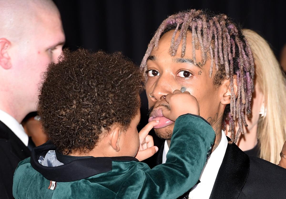 Wiz Khalifa (R) and son Sebastian Taylor Thomaz attend The 57th Annual GRAMMY Awards at the STAPLES Center on February 8, 2015 in Los Angeles, California