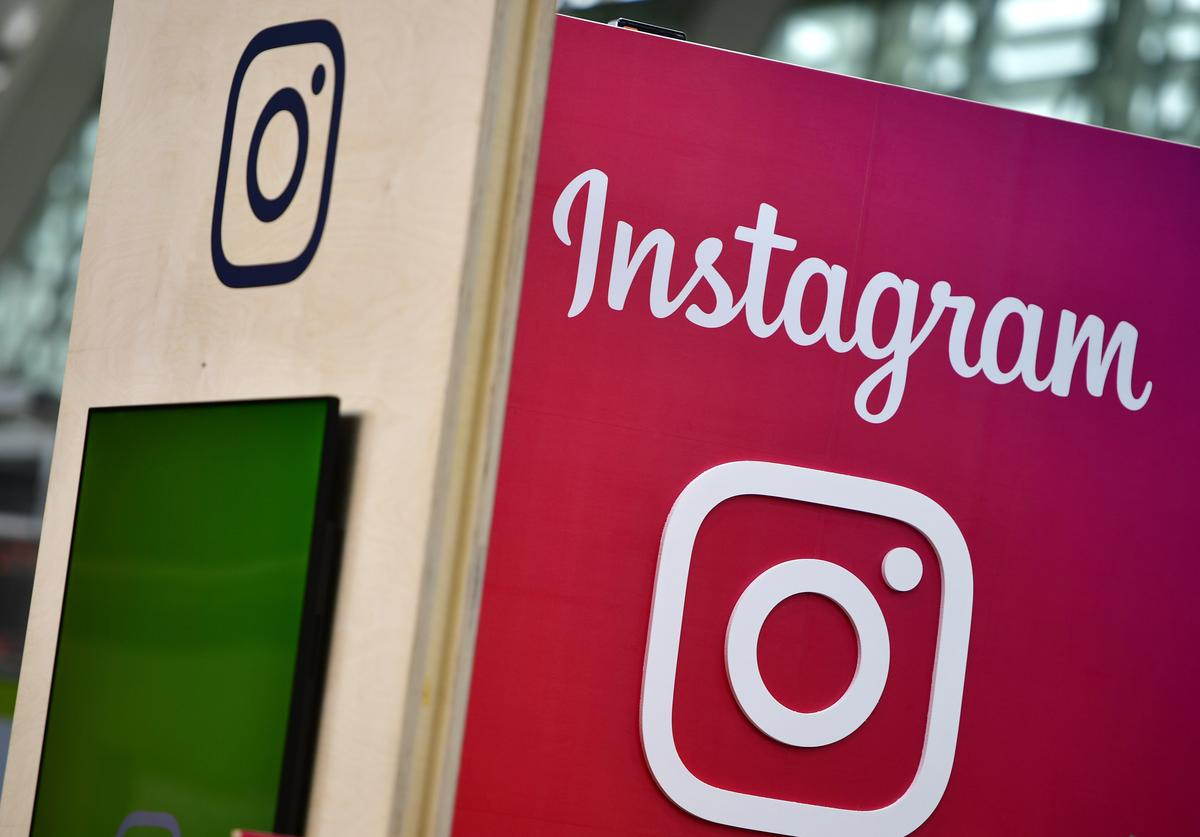 The Instagram logo is displayed at the 2018 CeBIT technology trade fair