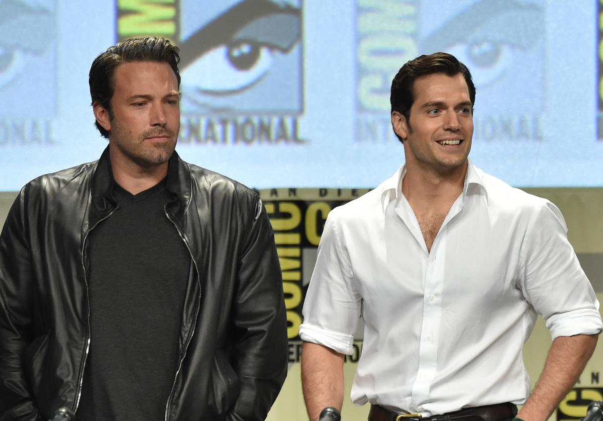 Actors Ben Affleck (L) and Henry Cavill attend the Warner Bros. Pictures panel and presentation during Comic-Con International 2014 at San Diego Convention Center on July 26, 2014 in San Diego, California.
