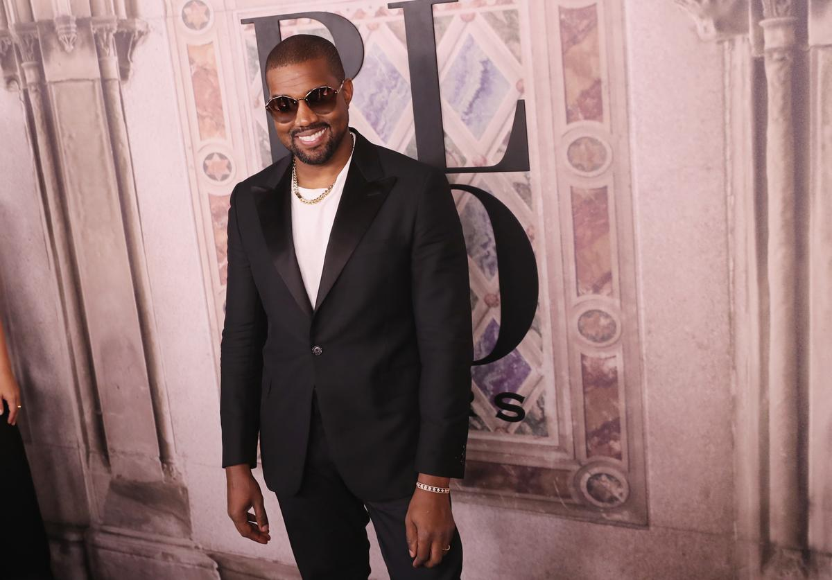 Kanye West attends the Ralph Lauren fashion show during New York Fashion Week at Bethesda Terrace on September 7