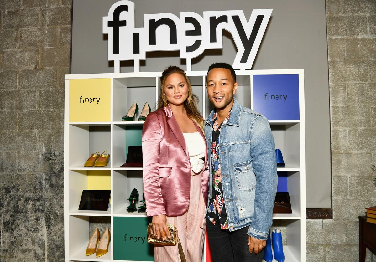 Chrissy Teigen and John Legend attend the Finery App launch party hosted by Brooklyn Decker at Microsoft Lounge on July 11, 2018 in Culver City, California.