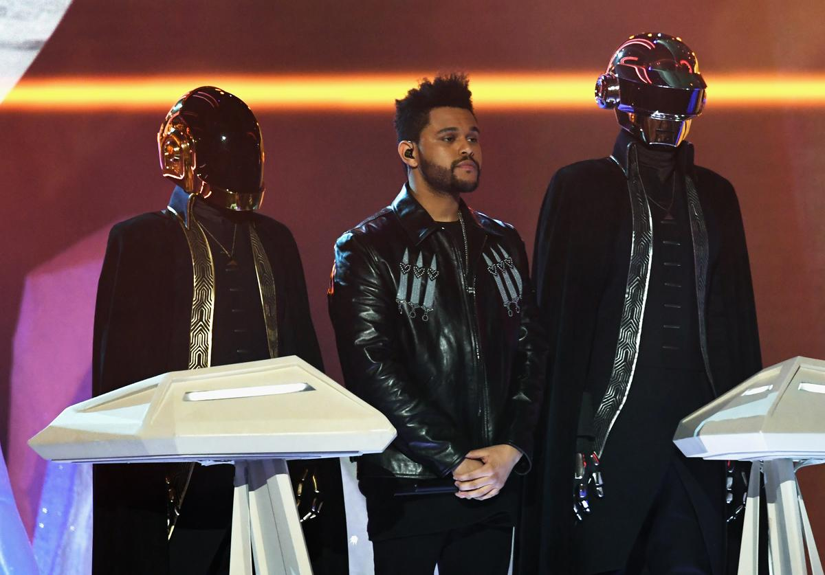 The Weeknd (C) and music group Daft Punk perform onstage during The 59th GRAMMY Awards at STAPLES Center on February 12, 2017 in Los Angeles, California