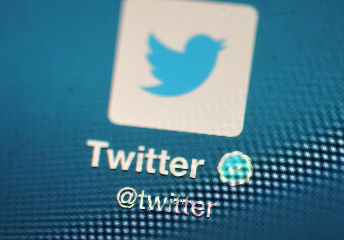 In this photo illustration, The Twitter logo is displayed on a mobile device as the company announced it's initial public offering and debut on the New York Stock Exchange on November 7, 2013 in London, England. Twitter went public on the NYSE opening at USD 26 per share, valuing the company's worth at an estimated USD 18 billion.
