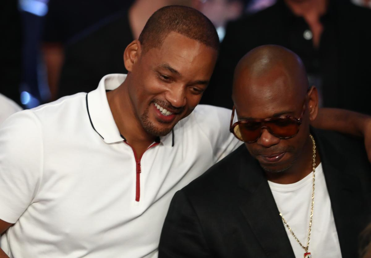 Actor Will Smith and actor/comedian Dave Chappelle are seen in attendance prior to the middleweight championship bout between Gennady Golovkin and Canelo Alvarez at T-Mobile Arena on September 15, 2018 in Las Vegas, Nevada.