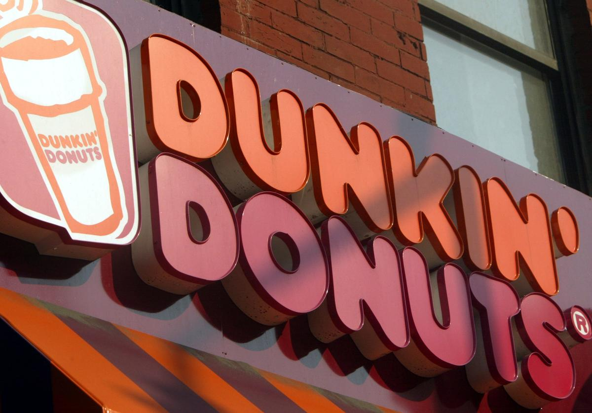 A Dunkin Donuts sign is seen May 13, 2004 in New York City. Dunkin Donuts plans to open 10 stores inside Wal-Mart stores within the next three months