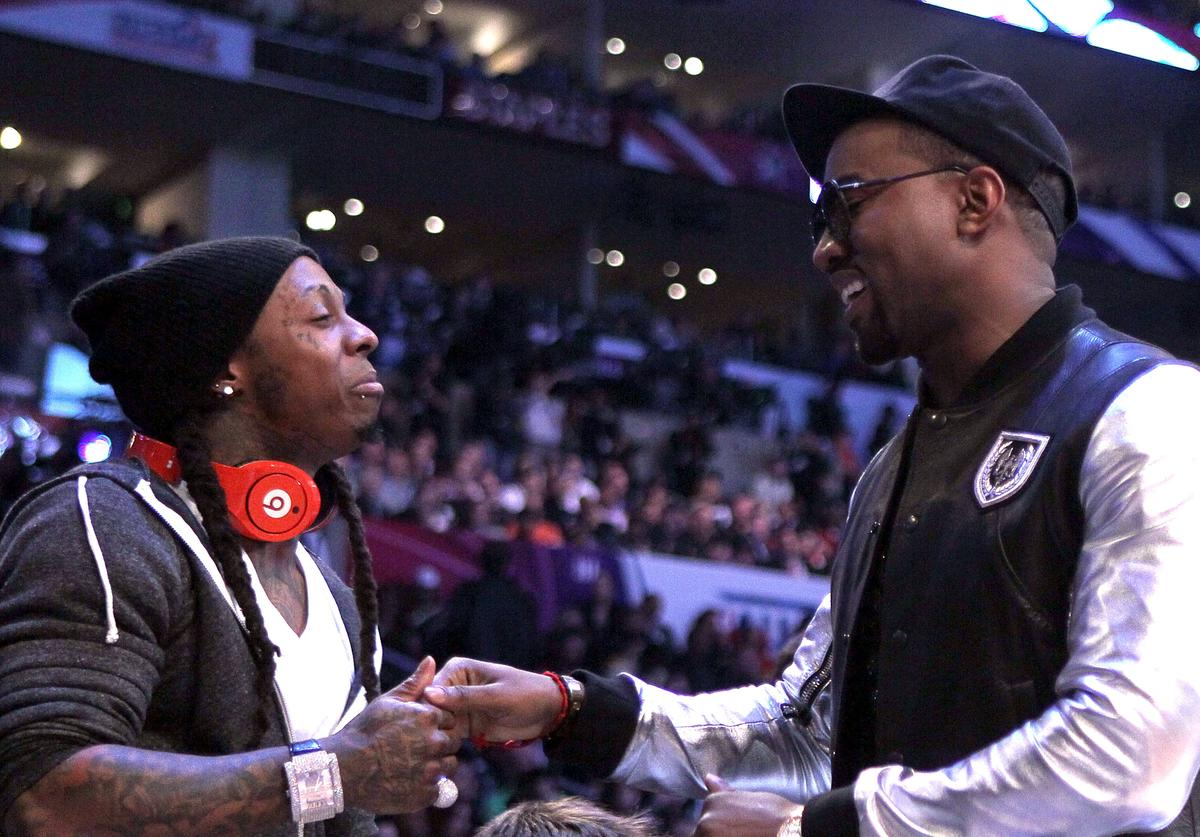 Lil Wayne (L) and Kanye West greet each other during the 2011 NBA All-Star game at Staples Center on February 20, 2011 in Los Angeles, California