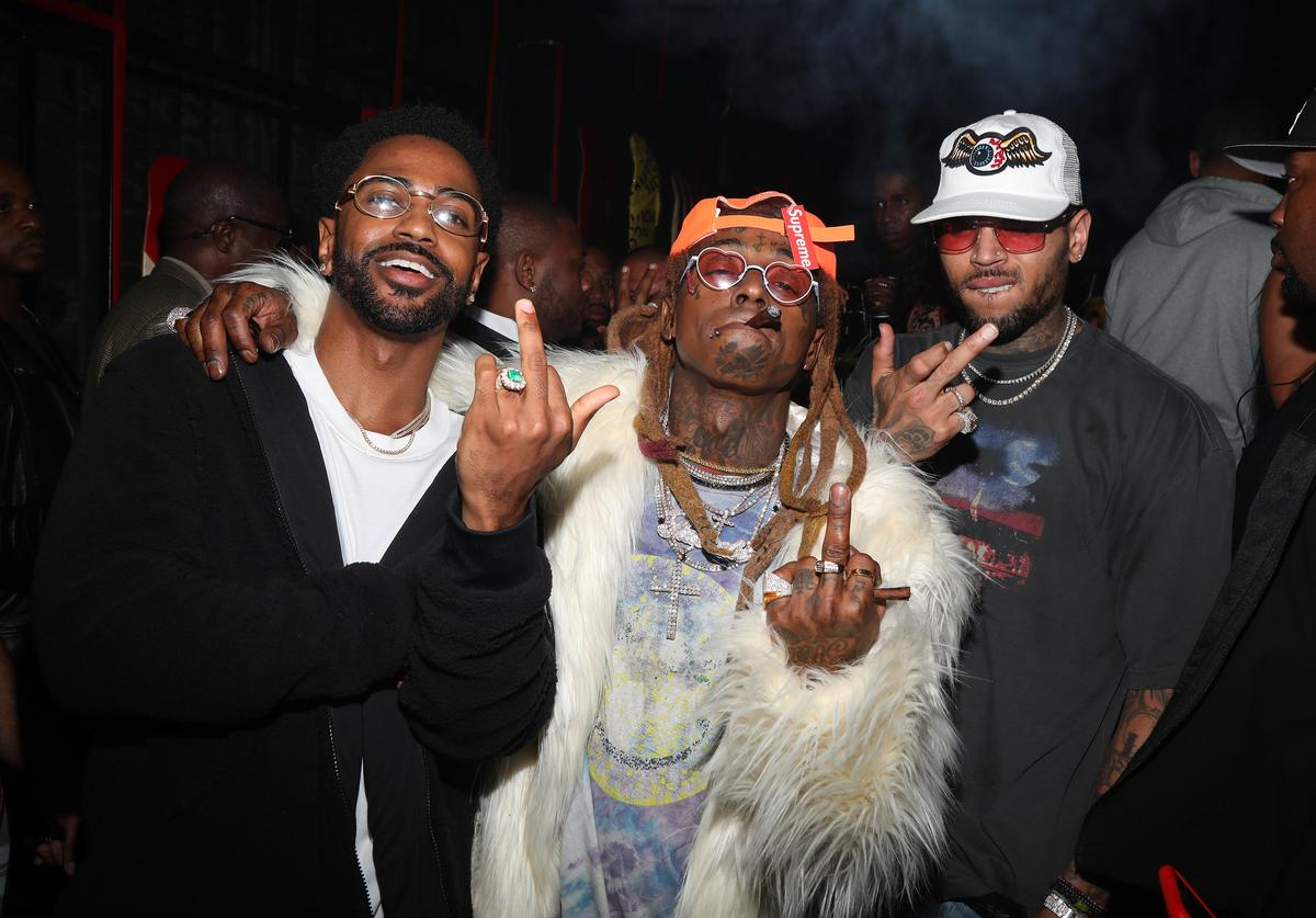 Big Sean and Lil Wayne and singer Chris Brown attend Lil Wayne's 36th birthday party and Carter V release at HUBBLE on September 28, 2018 in Los Angeles, California