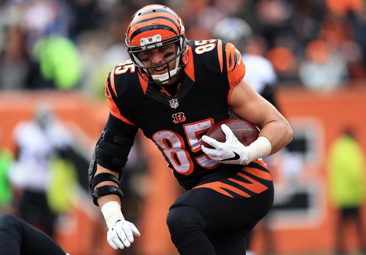 Tight end Tyler Eifert #85 of the Cincinnati Bengals catches a pass for a touchdown during the second quarter against the Baltimore Ravens at Paul Brown Stadium on January 3, 2016 in Cincinnati, Ohio.