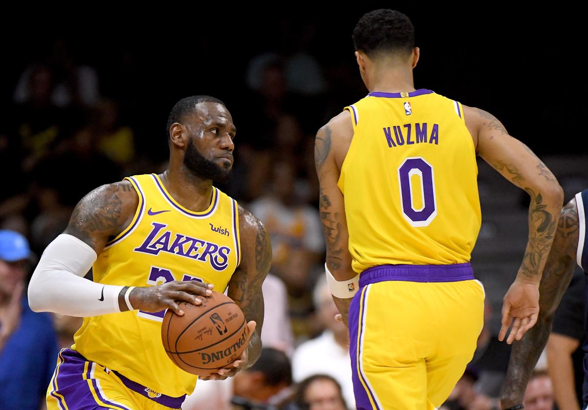 LeBron James #23 of the Los Angeles Lakers comes around a screen from Kyle Kuzma #0 during a preseason game against the Denver Nuggets at Valley View Casino Center on September 30, 2018 in San Diego, California.