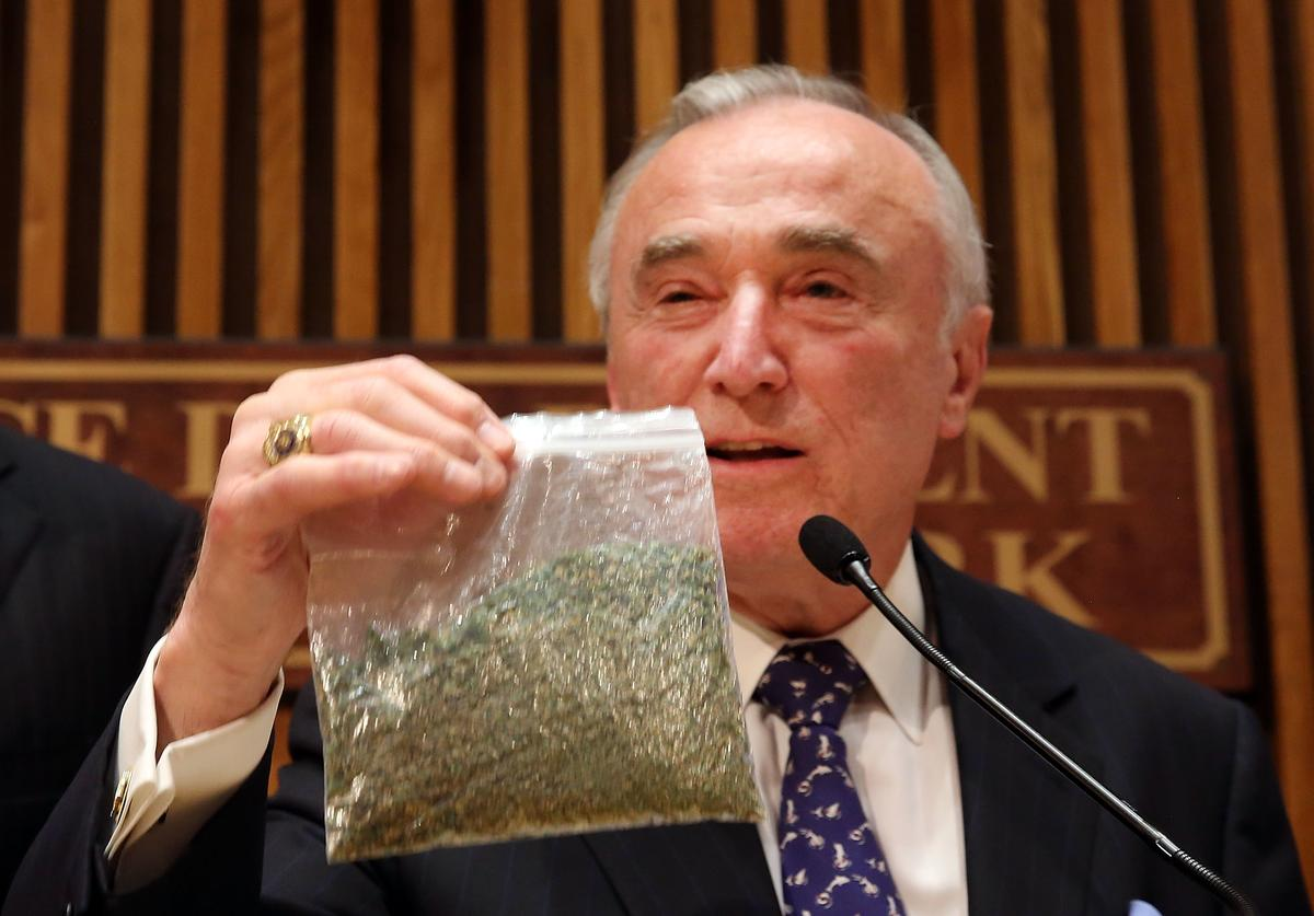 New York City Police Commissioner Bill Bratton holds up a bag of oregano to demonstrate what 25 grams of marijuana looks like at a news conference to announce changes to New York City's marijuana policy on November 10, 2014 in New York City.