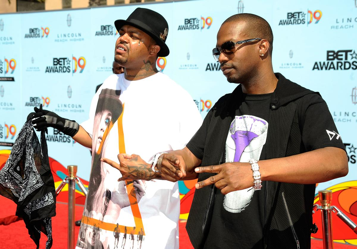 DJ Paul (L) and Juicy J of the group Three 6 Mafia arrive at the 2009 BET Awards held at the Shrine Auditorium on June 28, 2009 in Los Angeles, California