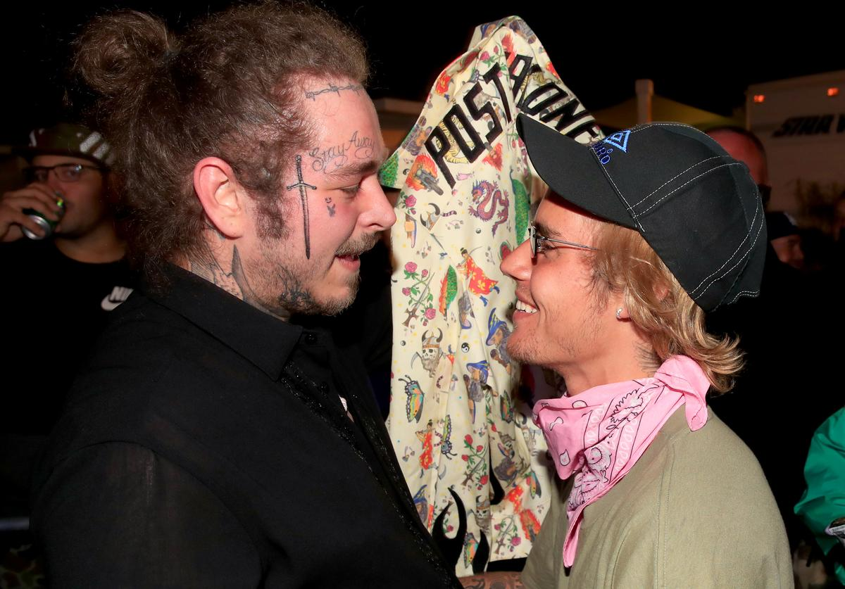 Post Malone and Justin Bieber speak backstage during 2018 Coachella Valley Music And Arts Festival Weekend 1 at the Empire Polo Field on April 14, 2018 in Indio, California