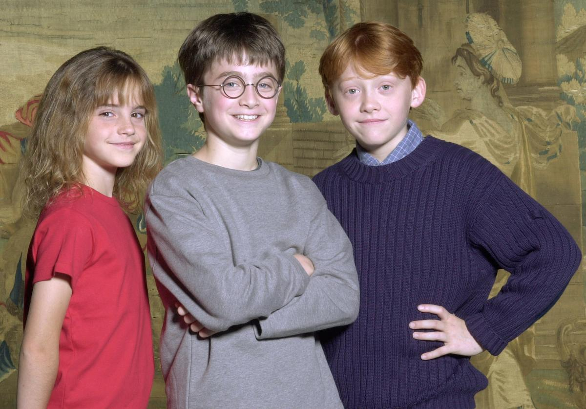 Warner Bros. Pictures announced August 21, 2000 that the young actor Daniel Radcliffe, center, has been named as the young actor who will play Harry Potter, in the upcoming film adaptation of the popular books by J.K. Rowling. Newcomers Rupert Grint, right, and Emma Watson will be taking on the roles of Ron and Hermione, Harry's best friends at Hogwarts