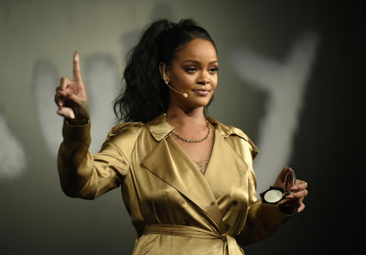 Rihanna gestures on stage during her Fenty Beauty talk in collaboration with Sephora, for the launch of her new Stunna Lip paint 'Uninvited' on September 29, 2018 in Dubai, United Arab Emirates