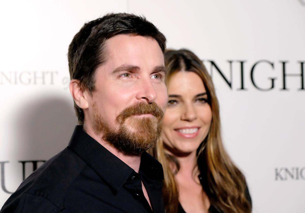 Actors Christian Bale (L) and Sibi Blazic attend the premiere of Broad Green Pictures' 'Knight Of Cups' on March 1, 2016 in Los Angeles, California.